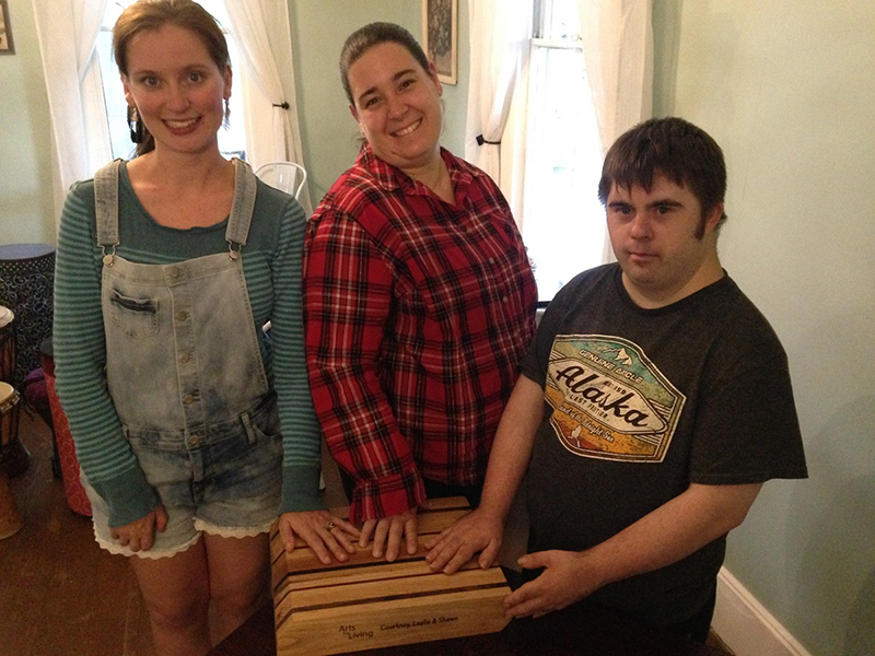 Courtney's House Group sanding their cutting board